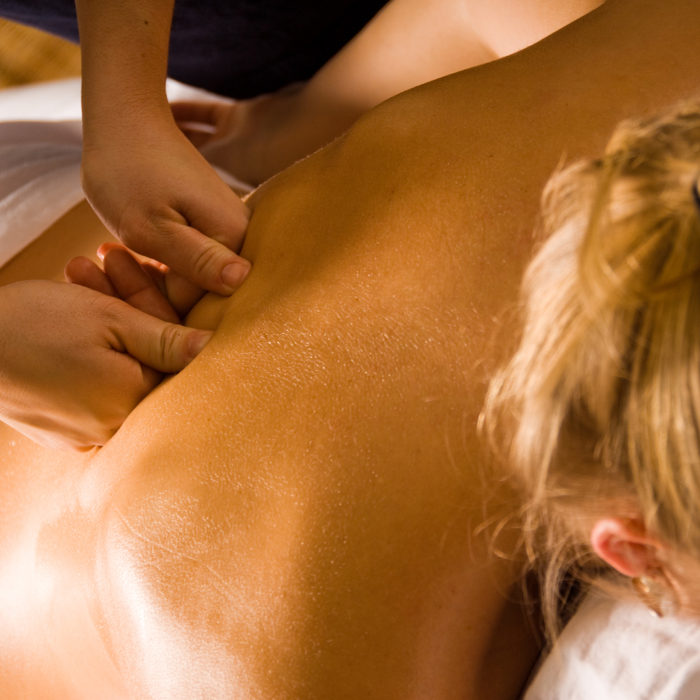 woman at a day spa getting a deep tissue massage