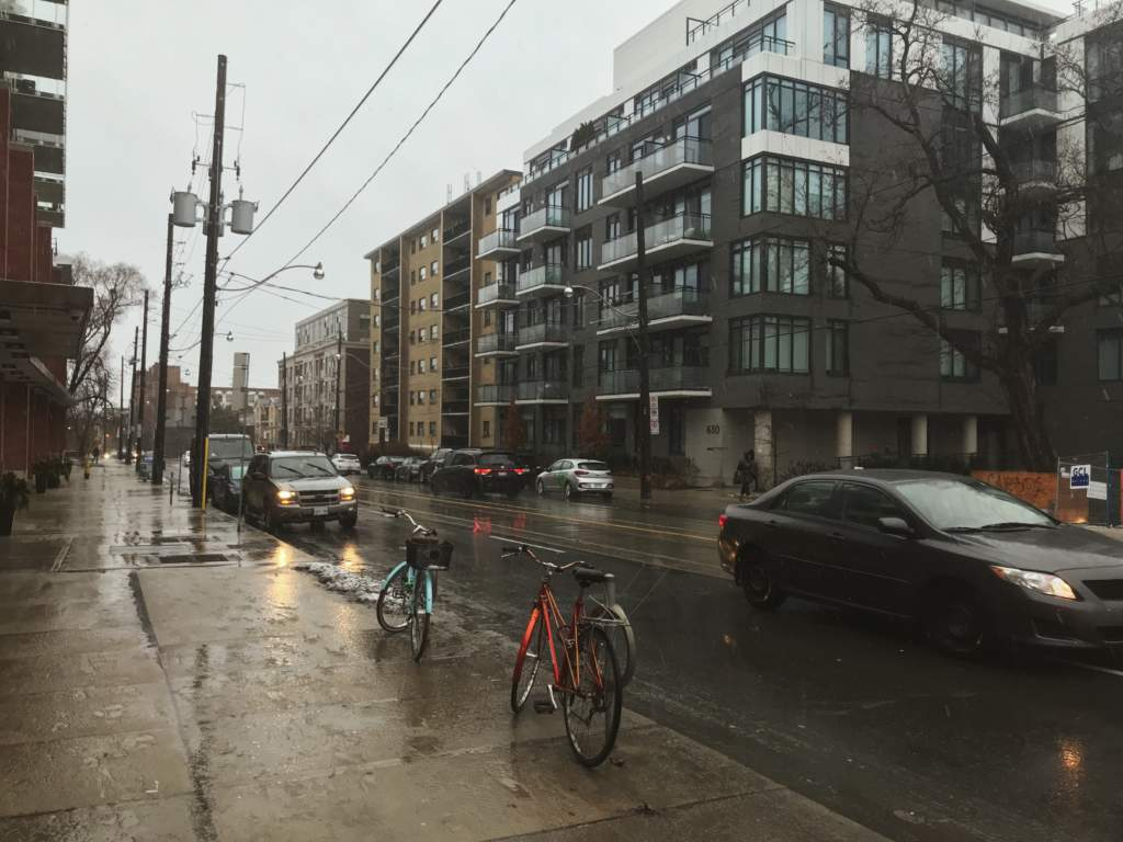 Toronto street with a mix of rain and snow coming down