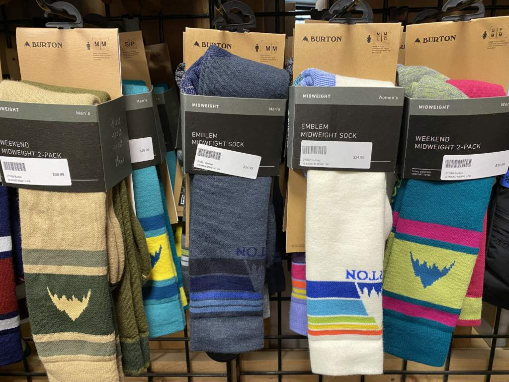 Colourful Burton ski and snowboard socks hanging in a store